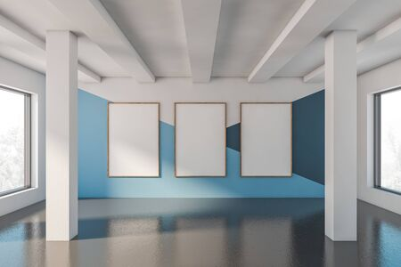 Empty room interior with white, blue and dark blue walls, concrete floor, columns and three vertical mock up poster frames. 3d rendering 版權商用圖片