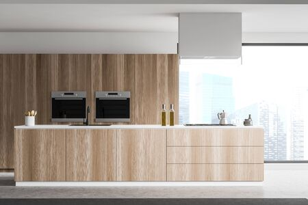 Wooden island with built in sink and cooker standing in panoramic kitchen with concrete floor and two built in ovens. 3d rendering 스톡 콘텐츠 - 133855439