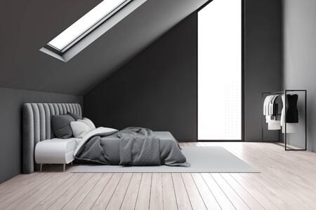 Side view of attic bedroom with gray walls, wooden floor, grey king size bed with white bedside tables and clothes on hangers. 3d rendering