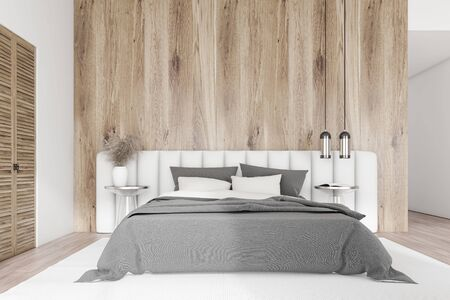 Interior of master bedroom with white and wooden walls, wooden floor, white king size bed with gray blanket, glass bedside tables and wardrobe. 3d rendering Zdjęcie Seryjne