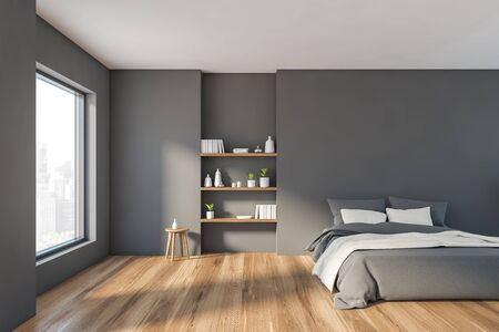 Interior of stylish minimalistic bedroom with grey walls, wooden floor, comfortable king size bed with gray blanket and bookshelves. Window with cityscape. 3d rendering