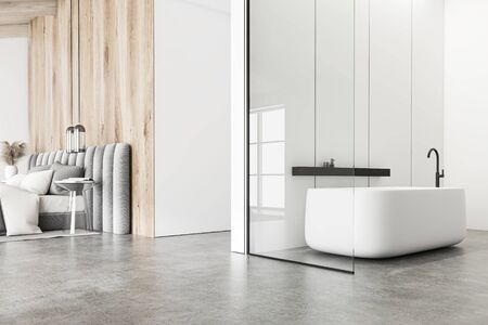 Interior of attic bathroom with white panel and wooden walls, concrete floor, comfortable bathtub and bedroom with gray king size bed in background. 3d rendering Zdjęcie Seryjne