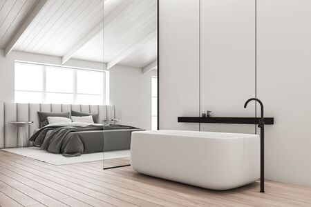 Corner of spacious attic bathroom with white panel walls, wooden floor, and bedroom with white king size bed in background. 3d rendering Zdjęcie Seryjne