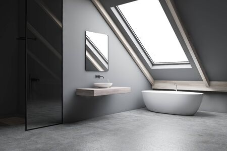 Corner of stylish attic bathroom with gray walls, concrete floor, comfortable bathtub, sink on wooden shelf and vertical shower stall. 3d rendering 스톡 콘텐츠