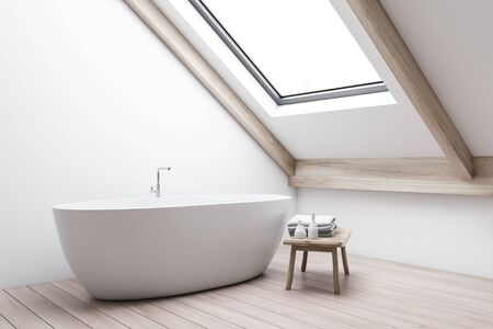 Corner of minimalistic attic bathroom with white walls, wooden floor and comfortable bathtub standing under window in the roof with bench beside it. 3d rendering Zdjęcie Seryjne