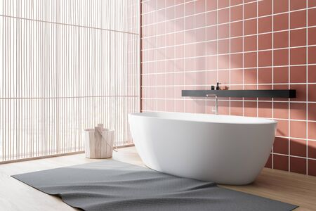 Corner of spacious bathroom with orange tile walls, wooden floor, comfortable white bathtub with shelf above it, panoramic window and wooden bucket. 3d rendering