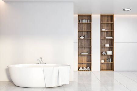 Interior of stylish bathroom with white walls, tiled floor, comfortable bathtub with towel on it and wooden shelves with beauty products. 3d rendering