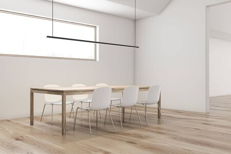 Corner of stylish attic dining room with white walls, wooden floor, long wooden table with white chairs and narrow window. 3d rendering Zdjęcie Seryjne
