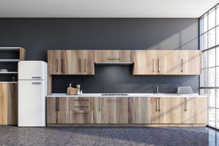 Interior of stylish kitchen with grey walls, tiled floor, wooden countertops and cupboards and big fridge. 3d rendering Stock Photo