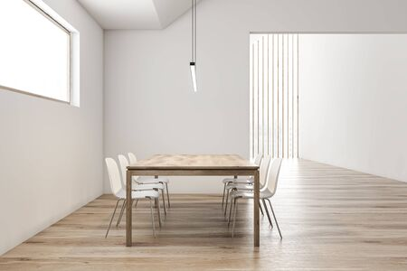 Side view of stylish attic dining room with white walls, wooden floor, long wooden table with white chairs and narrow window. 3d rendering