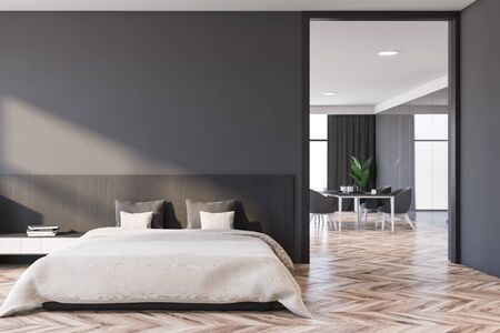 Interior of comfortable master bedroom with grey and wooden walls, wooden floor, king size bed and dining room in background. 3d rendering Stock Photo