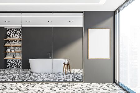 Interior of stylish bathroom with gray walls, mosaic floor, comfortable white bathtub standing near window with cityscape and vertical mock up poster frame. 3d rendering