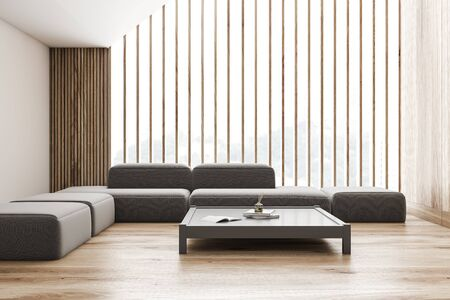 Interior of attic living room with white and wooden walls, wooden floor and comfortable gray sofa near Japanese style coffee table. 3d rendering