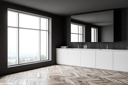 Corner of spacious bathroom with dark gray and tiled walls, wooden floor, double sink on white countertop, cabinet with glass doors and window with mountain view. 3d rendering 스톡 콘텐츠
