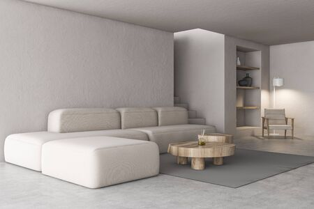 Corner of modern living room with crude white walls, comfortable sofa with round coffee tables and armchair with lamp near wooden shelves with vases. 3d rendering
