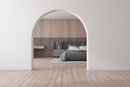Interior of modern bedroom with wooden walls and floor, comfortable king size bed, wooden table with armchair and arched door. 3d rendering
