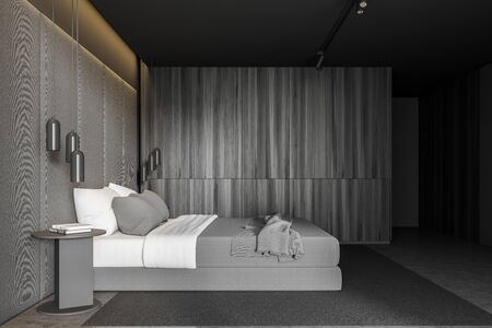 Side view of master bedroom with grey and dark wooden walls, concrete floor, king size bed standing on gray carpet and two round bedside tables. 3d rendering