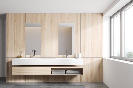 Interior of spacious loft bathroom with white and wooden walls, concrete floor, double sink with wooden shelf under it and window with mountain view. 3d rendering Zdjęcie Seryjne