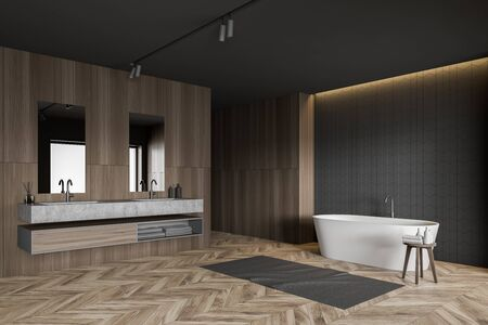 Corner of spacious bathroom with gray tile and dark wooden walls, wooden floor, comfortable white bathtub and double sink with two mirrors. 3d rendering