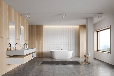 Interior of stylish bathroom with white tile and wooden walls, concrete floor, comfortable white bathtub and double sink with two mirrors. 3d rendering Zdjęcie Seryjne