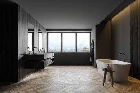 Interior of loft bathroom with grey and dark wooden walls, wooden floor, comfortable bathtub with water, double sink and window with mountain view. 3d rendering Zdjęcie Seryjne