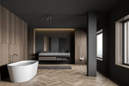 Interior of stylish bathroom with gray tile and dark wooden walls, wooden floor, column, comfortable white bathtub and double sink with two mirrors. 3d rendering