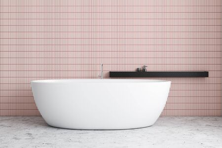 Interior of minimalistic bathroom with pink tile walls, stone floor, comfortable white bathtub and black shelf with beauty products. 3d rendering