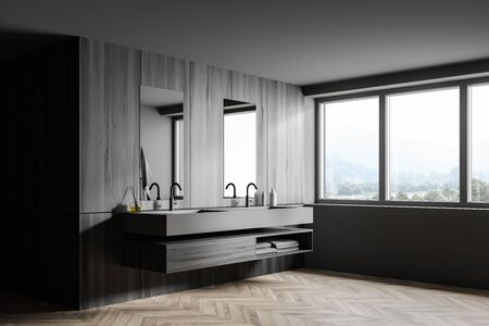 Corner of spacious loft bathroom with gray and dark wooden walls, wooden floor, double sink with wooden shelf under it and window with mountain view. 3d rendering