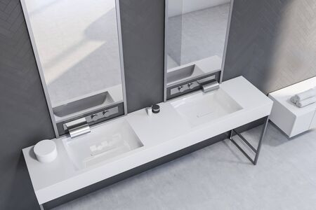 Top view of stylish bathroom with gray wooden walls and comfortable double sink with two mirrors standing on white countertop. 3d rendering