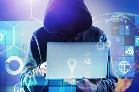 Hacker using laptop in city with double exposure of Earth and blurry digital interface. Concept of data theft. Toned image.