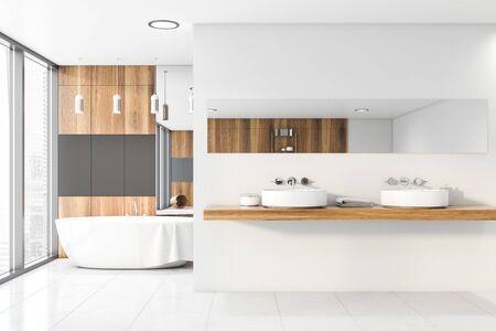 Interieur des modernen Badezimmers mit weißen, grauen und Holzwänden, Fliesenboden, komfortabler Badewanne und Doppelwaschbecken mit horizontalem Spiegel auf Holzregal. 3D-Rendering Standard-Bild