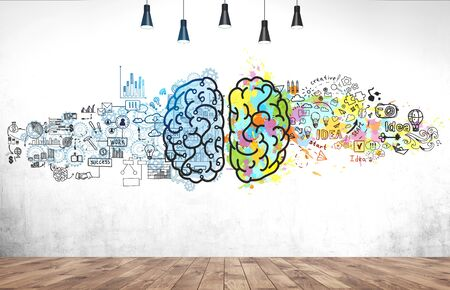 Bright brain sketch drawn on concrete wall in room with wooden floor. Concept of creative thinking and brainstorming Stock Photo
