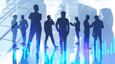 Silhouettes of business people in Moscow city with double exposure of blurry graph. Concept of stock market. Toned image