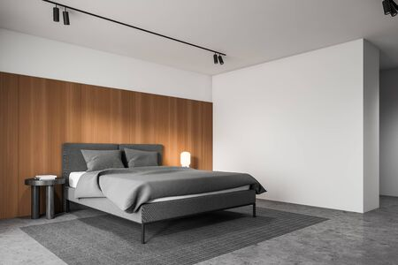 Corner of stylish hotel suite with white and wooden walls, concrete floor, comfortable king size bed and round bedside table. 3d rendering Imagens