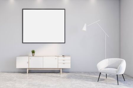 Interior of stylish living room with white walls, concrete floor, white cabinet with horizontal mock up poster frame hanging above it and white armchair with floor lamp. 3d rendering Stock Photo
