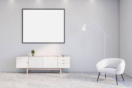 Interno di un elegante soggiorno con pareti bianche, pavimento in cemento, armadio bianco con cornice orizzontale per poster finta appesa sopra e poltrona bianca con lampada da terra. rendering 3d Archivio Fotografico