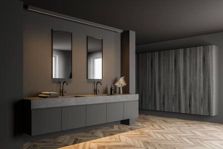 Corner of modern bathroom with grey walls, wooden floor, double sink with two vertical mirrors and dark wooden cabinets. 3d rendering Reklamní fotografie
