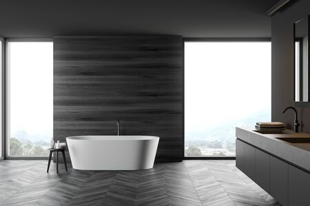 Interior of modern bathroom with grey and dark wooden walls, wooden floor, comfortable bathtub and stone double sink. 3d rendering