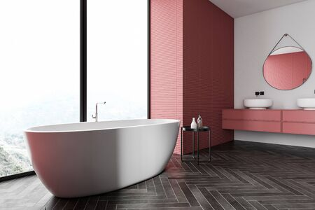 Corner of stylish panoramic bathroom with white and red walls, black wooden floor, comfortable bathtub and double sink with round mirror standing on red countertops. 3d rendering Reklamní fotografie