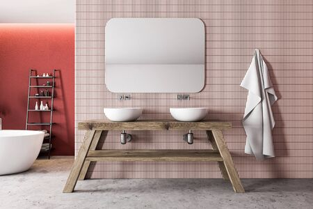 Interior of luxury bathroom with red and pink tile walls, stone floor, comfortable bathtub and shelves with towels and beauty products. Double sink standing on wooden countertop. 3d rendering