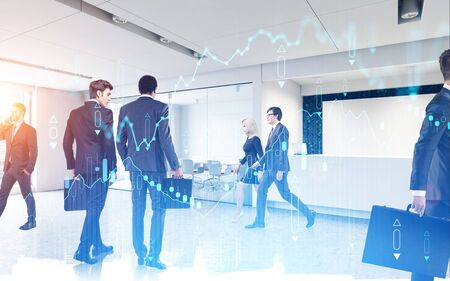 Diverse business people working together in modern office with double exposure of cityscape and blurry digital graph. Concept of market analysis and investment. Toned image Фото со стока
