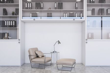 Comfortable beige armchair standing in modern office lounge with white walls, concrete floor, white bookcase with folders and stylish lamp. 3d rendering Reklamní fotografie