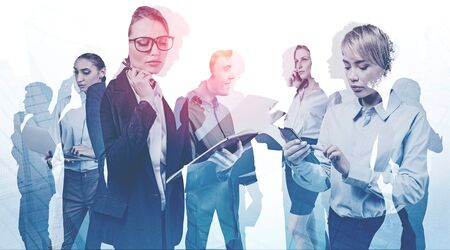 Diverse business people working together in abstract city. Business meeting and teamwork concept. Toned image double exposure Stock fotó