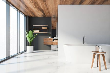 Interior of luxury bathroom with white and grey walls, marble floor, comfortable white bathtub in foreground and round sink standing on wooden countertop. Panoramic window. 3d rendering