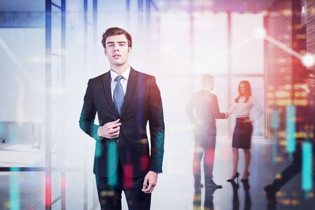 Confident European businessman and his team working together in blurry office with double exposure of abstract cityscape and financial charts. Stock market and leadership concept. Toned image