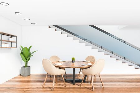 Interior of minimalistic dining room with white walls, wooden floor, round table with beige chairs near staircase and shelves with dishes. 3d rendering