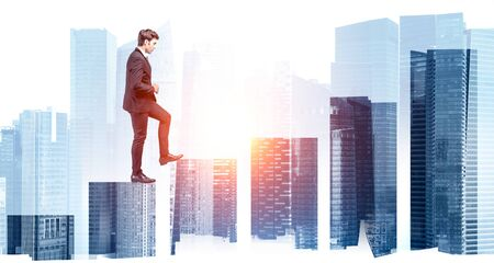 Side view of young businessman climbing bar chart in abstract sunlit city with creative double exposure effect. Concept of career ladder and stock market. Toned image Banco de Imagens