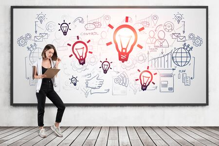 Young European businesswoman or student reading report on clipboard standing near whiteboard with creative business idea sketch drawn on it. Concept of business education and strategy