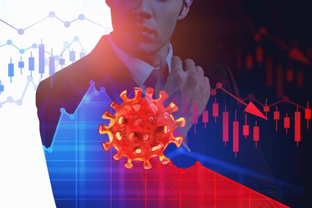 Unrecognizable thoughtful businessman standing over blurry background with double exposure of falling graphs and coronavirus sketch. Concept of financial crisis due to covid 19 pandemic. Toned image