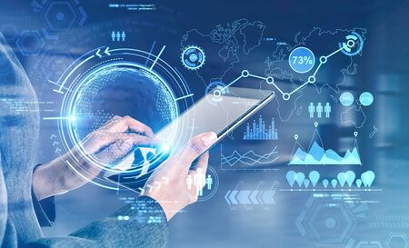 Hand of businesswoman using tablet in blurry room with double exposure of futuristic online work interface. Toned image. Elements of this image furnished by NASA
